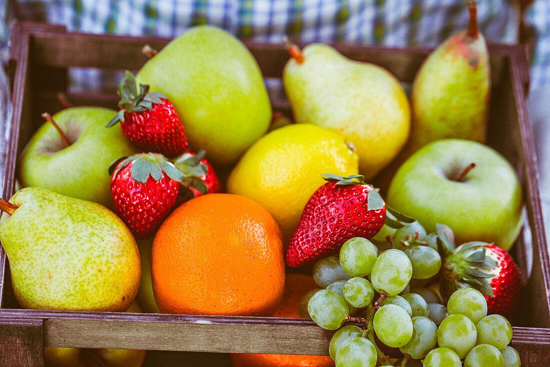 Farmer with basket of fresh fruits
