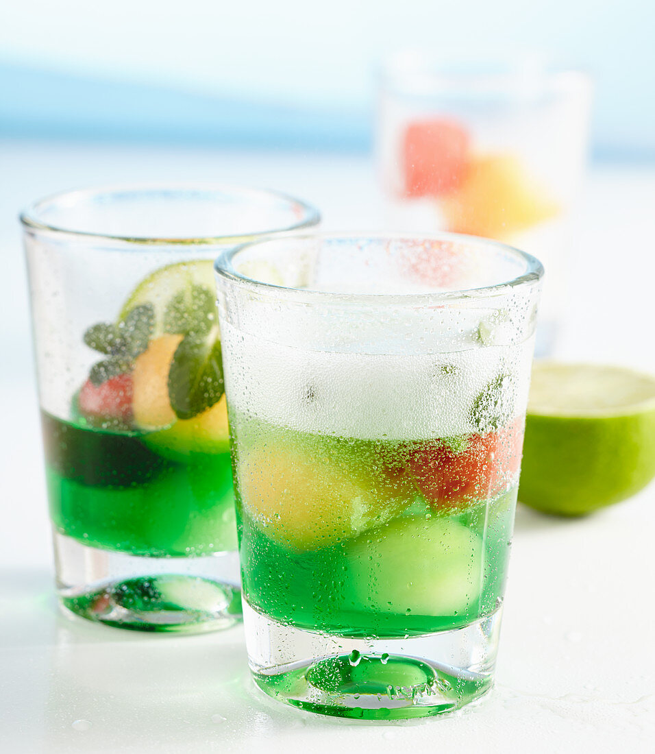 Non-alcoholic melon and mint punch served in glasses with melon balls