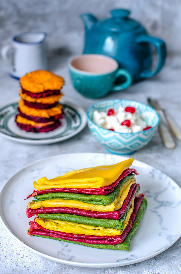 Thin pancakes with carrot and beet juice, fritters of beets, carrots and ricotta
