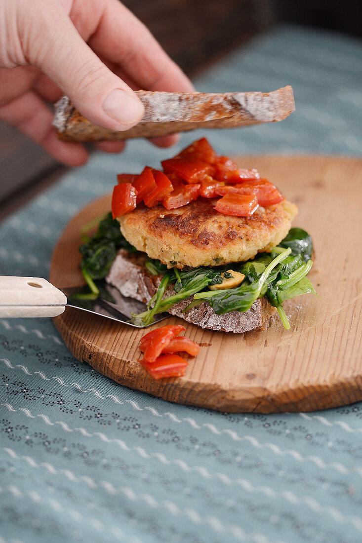 A Kaspressknödel (bread and cheese dumplings) sandwich with pepper ragout