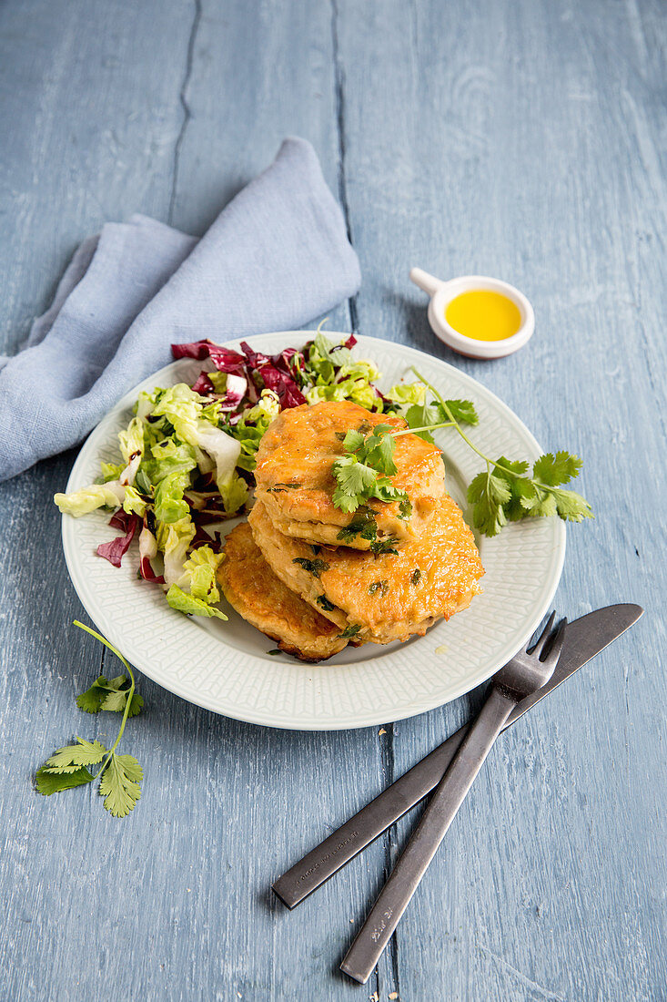 Chickpea fritters with a mixed leaf salad