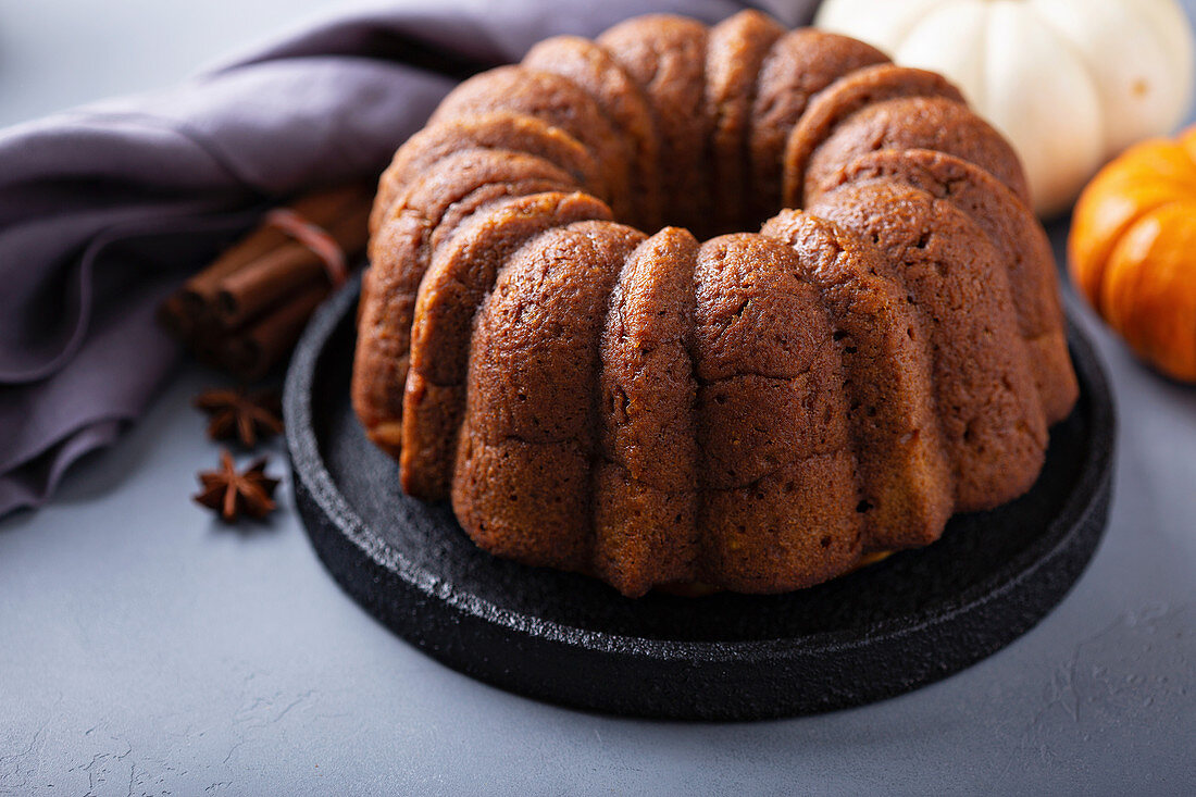 Pumpkin bundt cake with fall spices on a plate