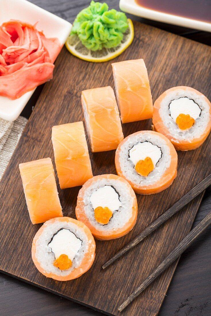 Sushi rolls philadelphia with caviar, salmon and avocado
