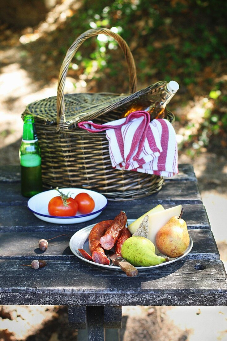 Picnic in the park with chorizo, cheese, fruit and wine