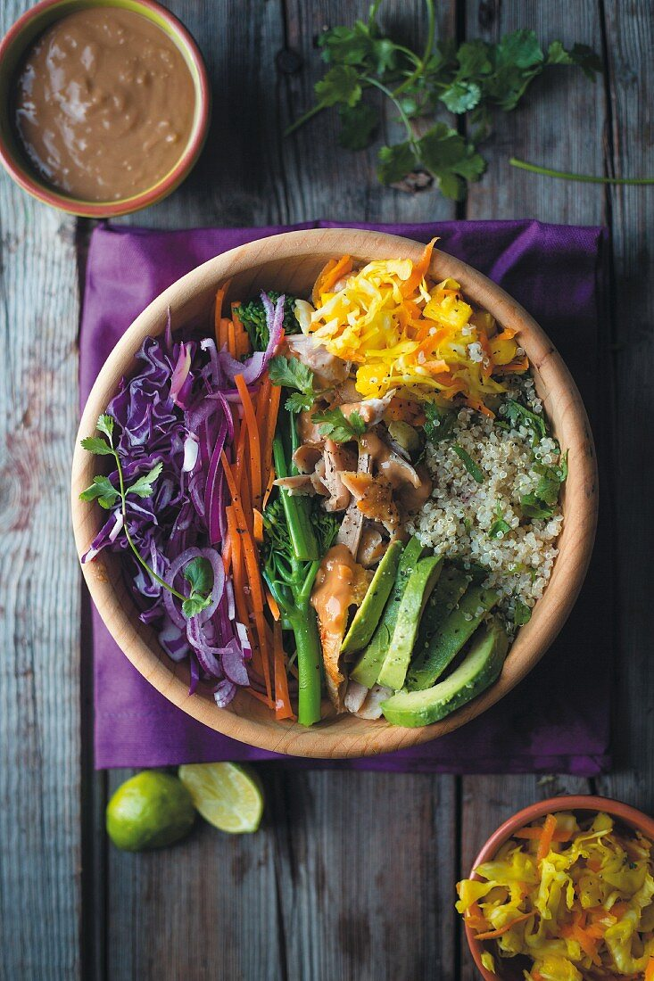 Power Bowl with quinoa, chicken, avocado, vegetables and peanut dip