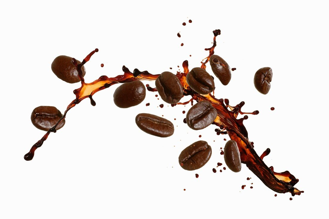 Coffee beans with a splash of coffee