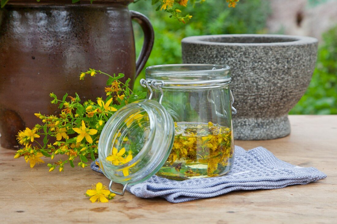 Homemade St. John's Wort oil in a glass jar