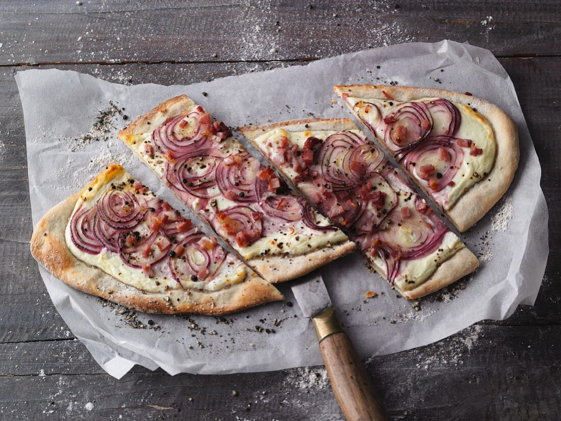 Alsace-style tarte flambée with red onions, quark and ham