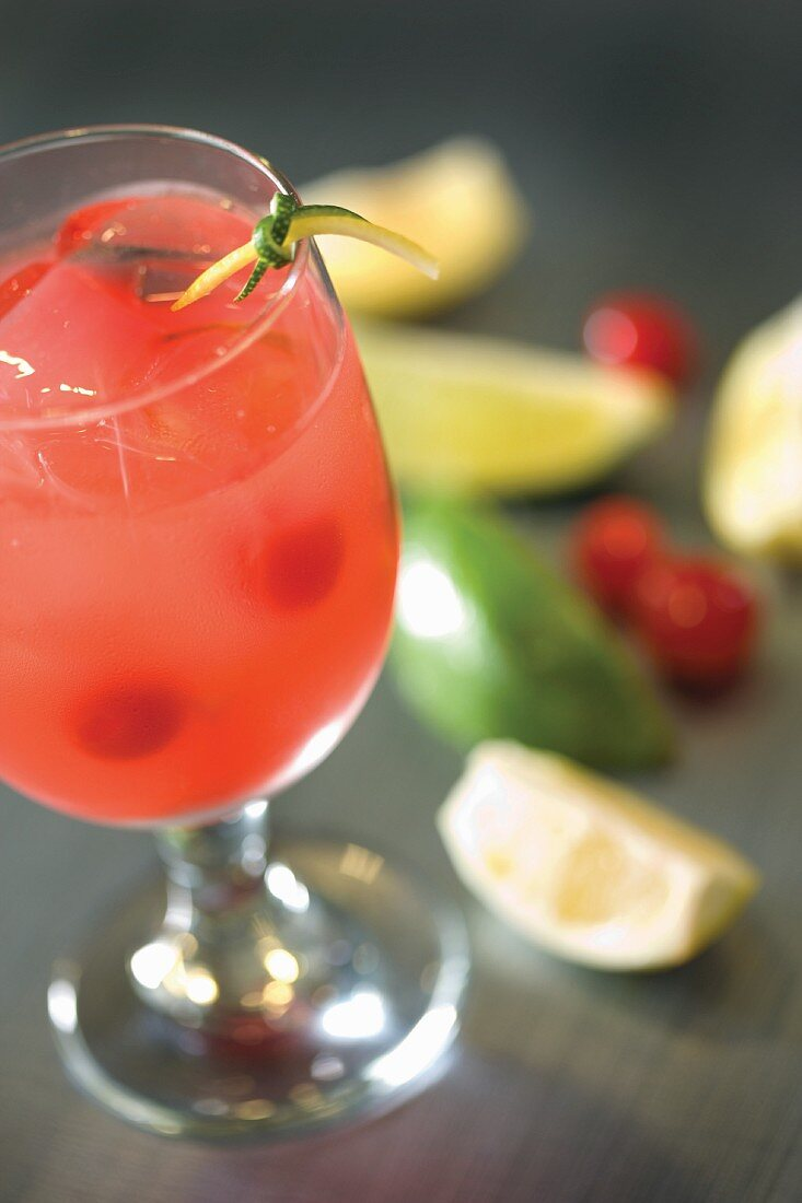 Lemon lime mocktail in pink with cherries