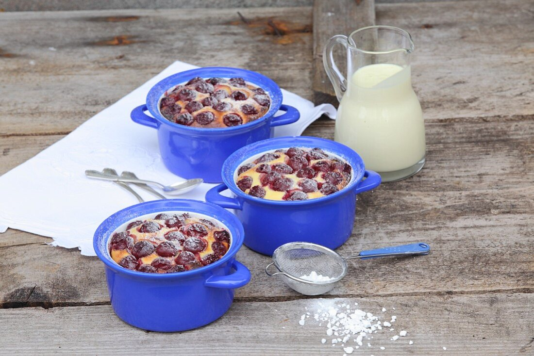 Cherry clafoutis with powdered sugar and vanilla sauce