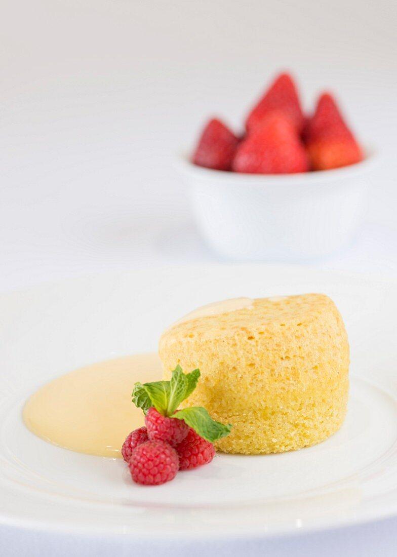 Sponge pudding, custard and strawberries