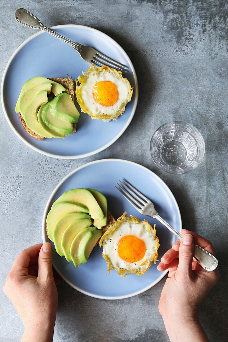 Baked eggs in potato nests with avocado toast
