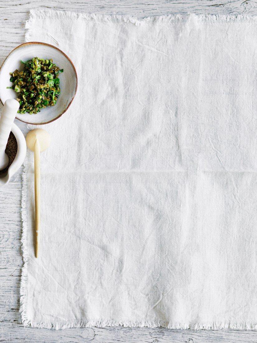 Bowl of salsa, green chillies