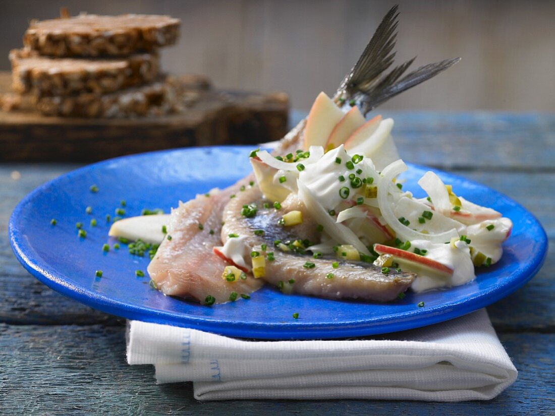 Housewife style herring in a creamy sauce with onions and apples