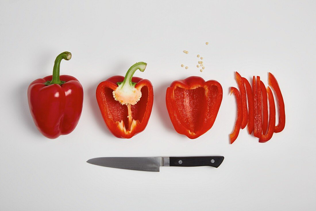 Red pepper being chopped into slices (step by step)