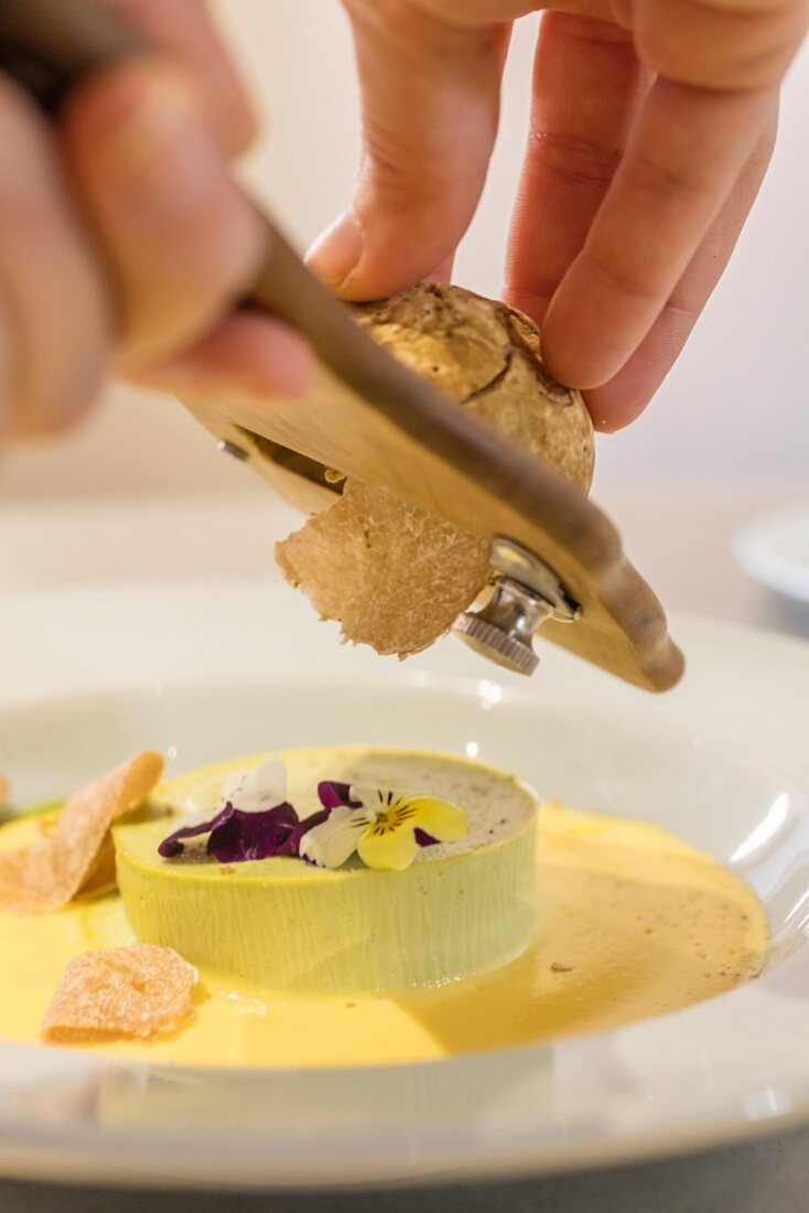 Truffle being shaved over a dessert in the Piedmont region of Italy