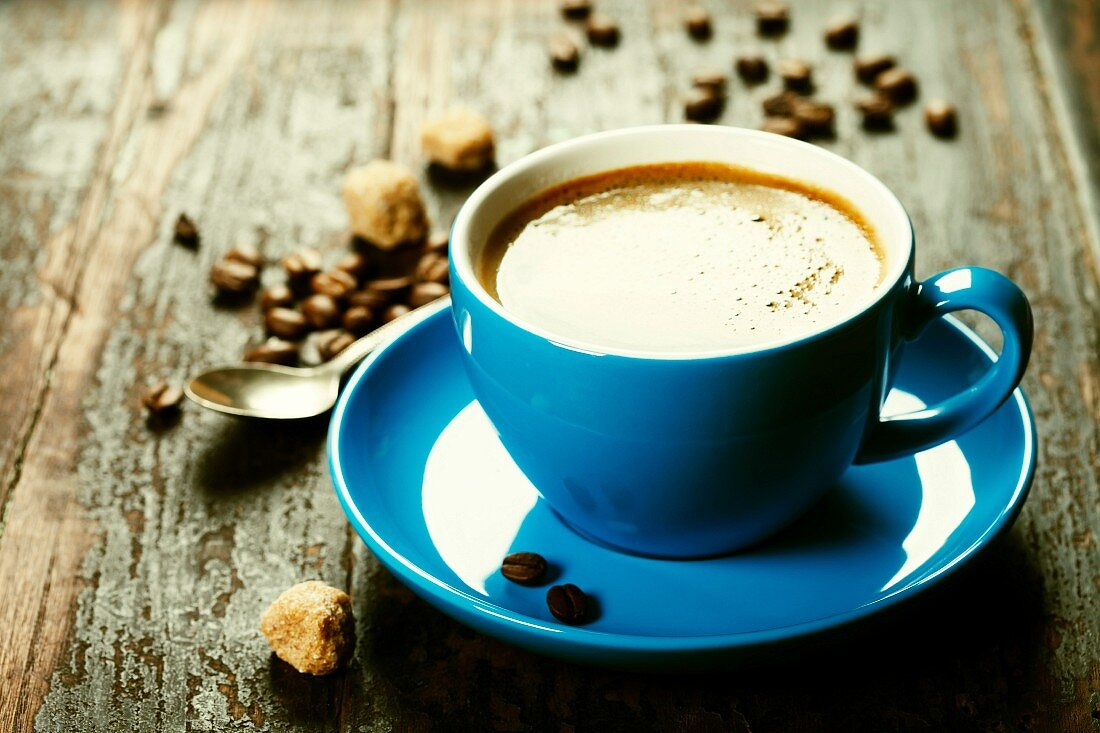 Blue coffee cup on vintage wooden background