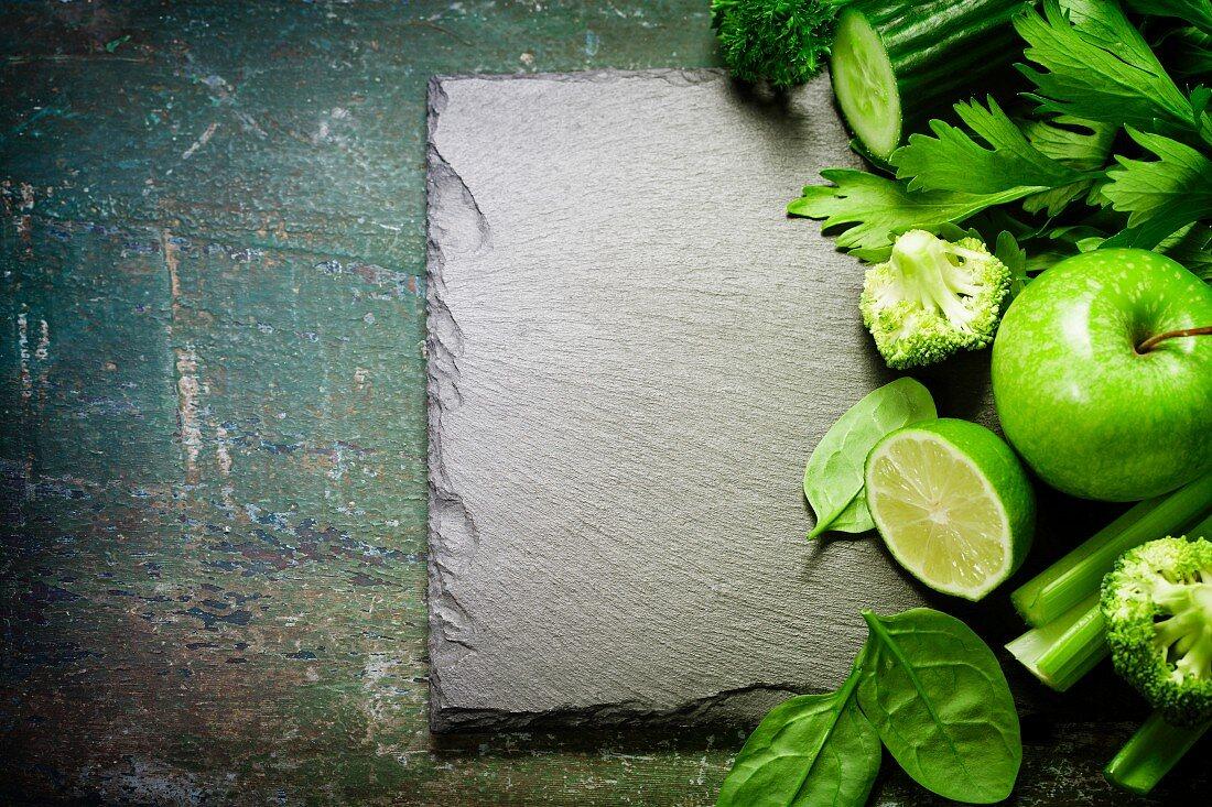 Fresh green vegetables on vintage background