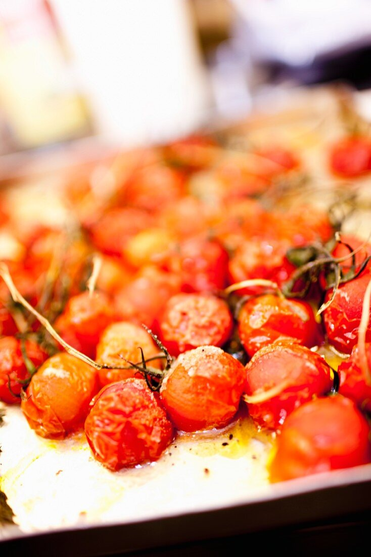 Oven-roasted tomatoes on a baking tray