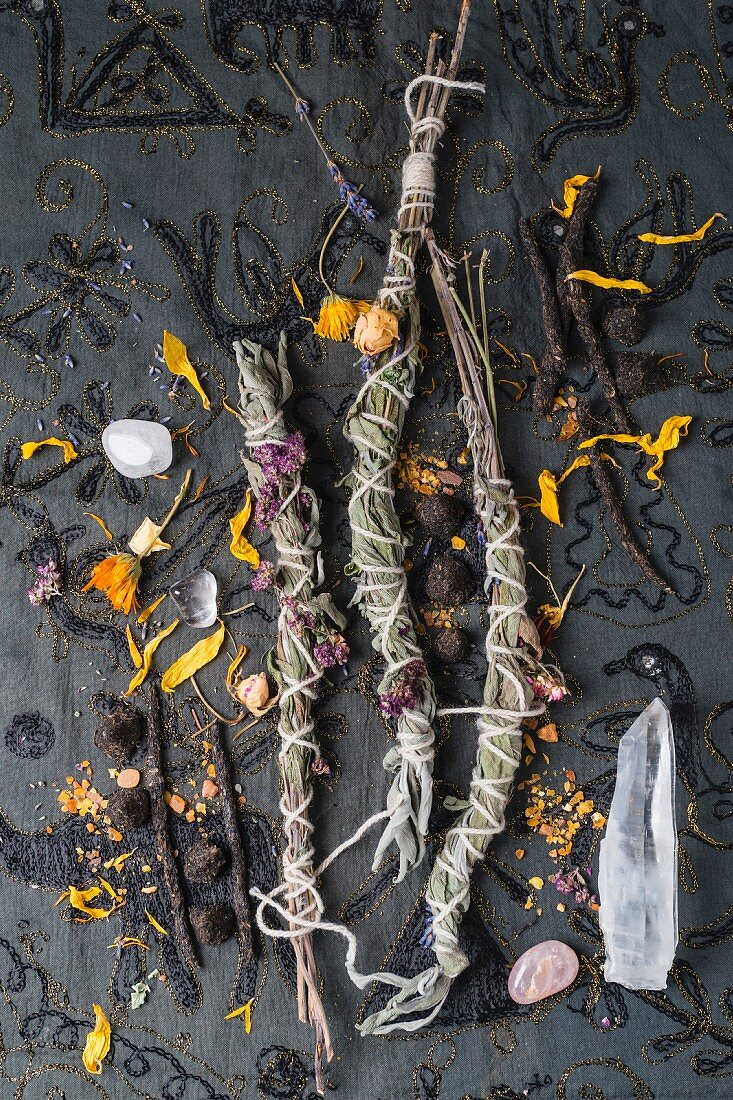 Homemade incense sticks, cones, and herbs for smoking, with crystals