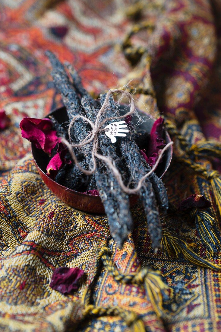 Smudge sticks hand-made from charcoal, resin, dried herbs and rose petals