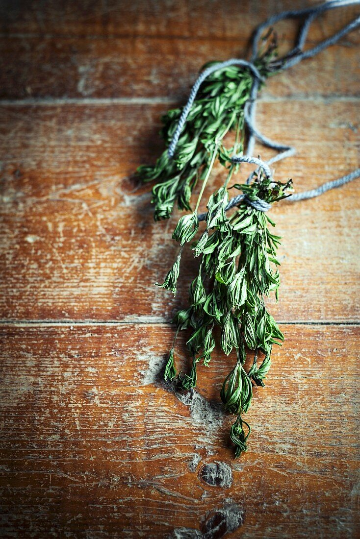 Dried woodruff on a wooden background