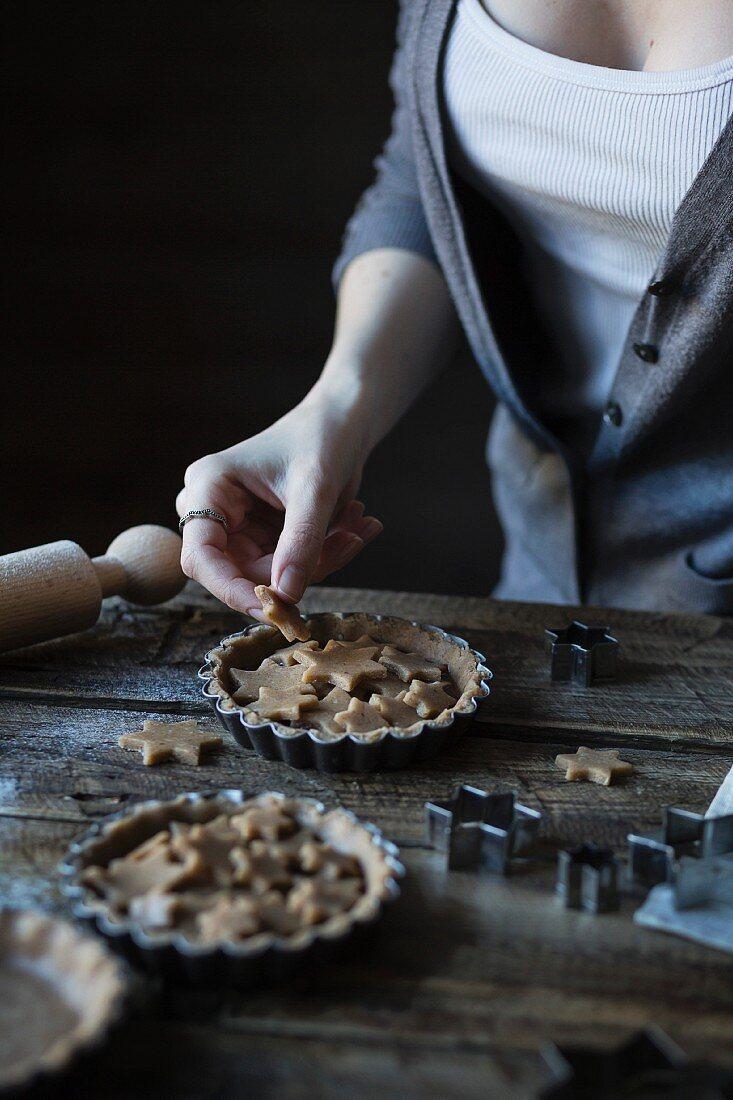 Woman decorating a tart