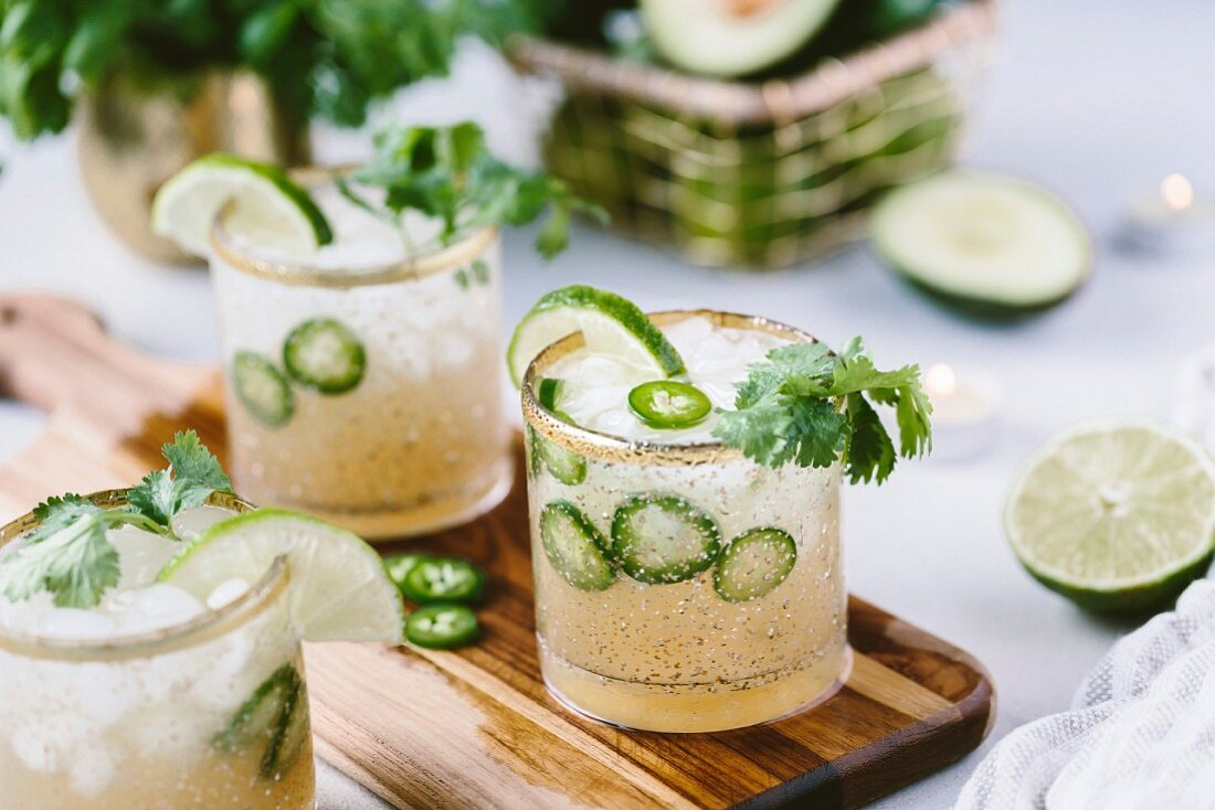 A couple glasses of spicy jalapeno margaritas
