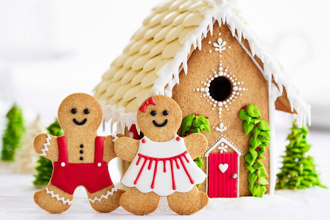 Gingerbread house with gingerbread couple in front