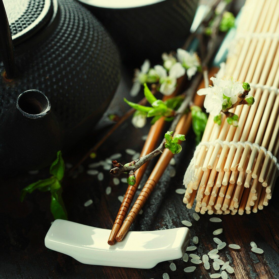 Chinese Tea Set, chopsticks and sakura branch on rustic wooden table