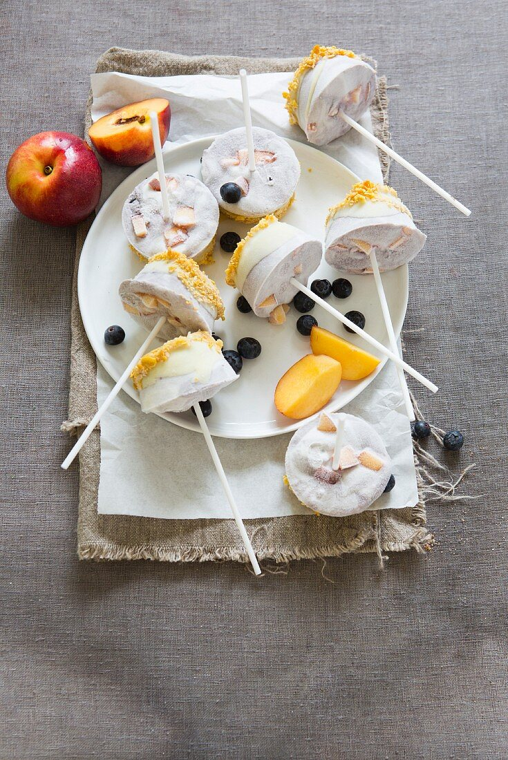 Nectarine and blueberry ice lollies