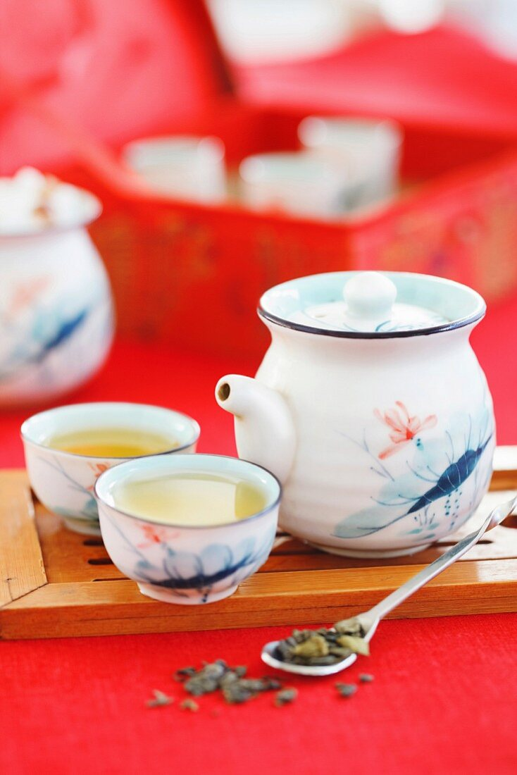 Green tea in a porcelain service