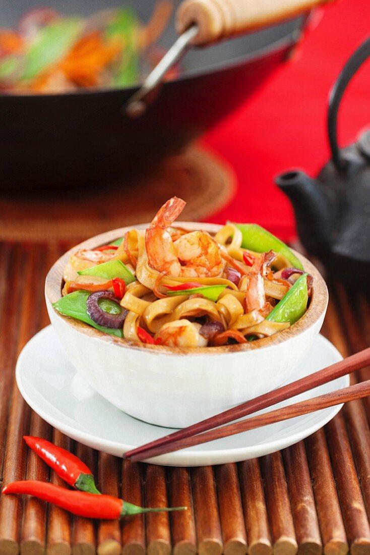 Asian stir fried noodle with vegetables and shrimps