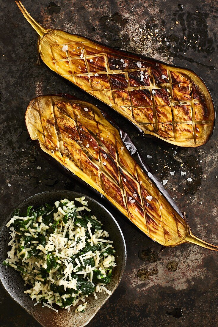 Oven-baked aubergine with spinach rice