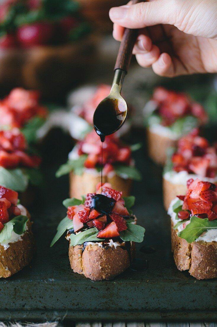 Balsamic reduction on a Strawberry and Ricotta Bruschetta