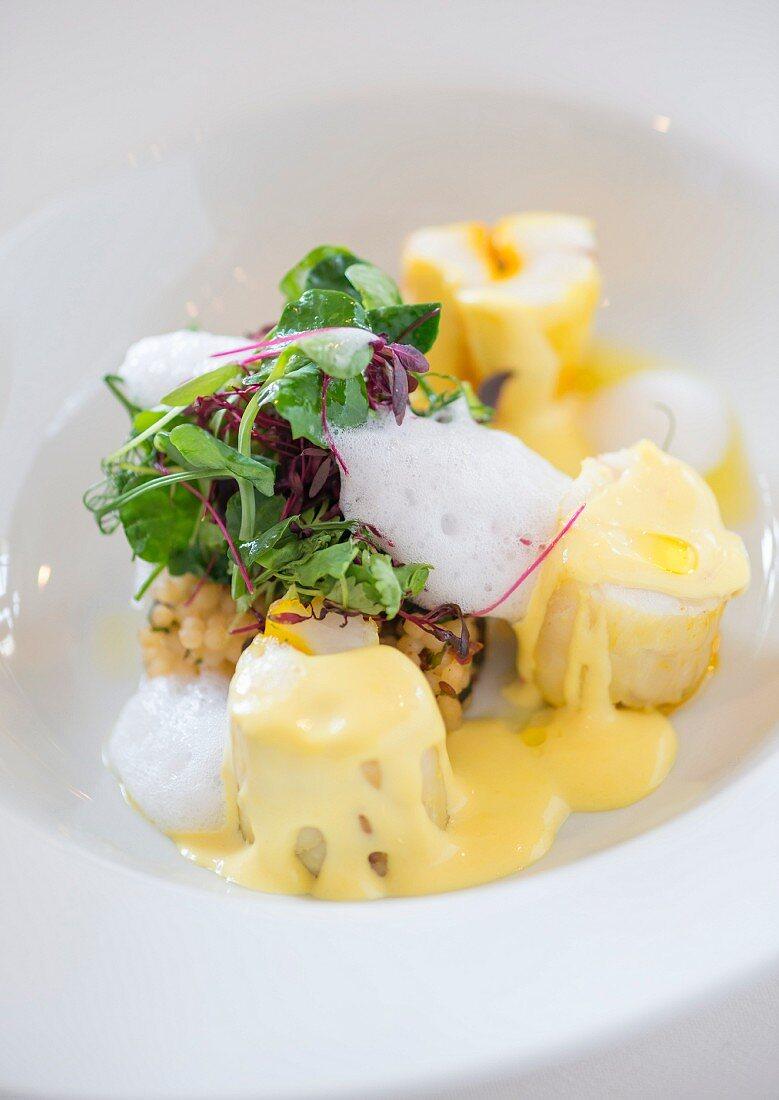 Saffron and corriander infused monkfish, cous cous, black olives and lemon foam