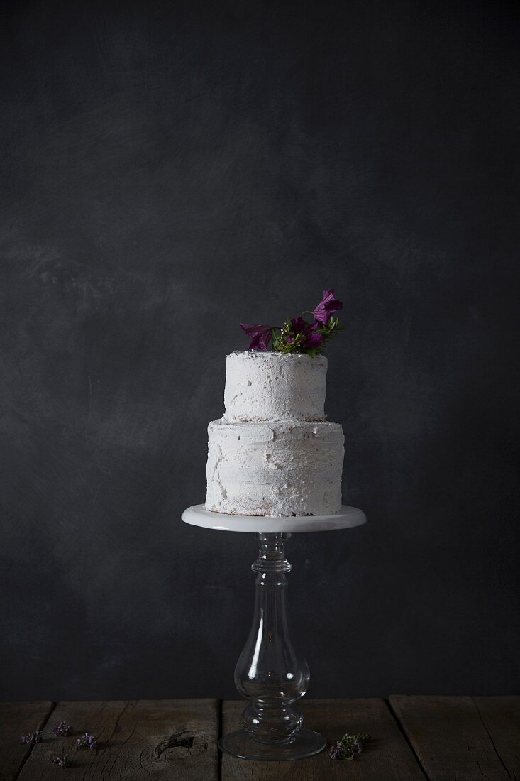 Homemade cake, flower decorated, on a stand