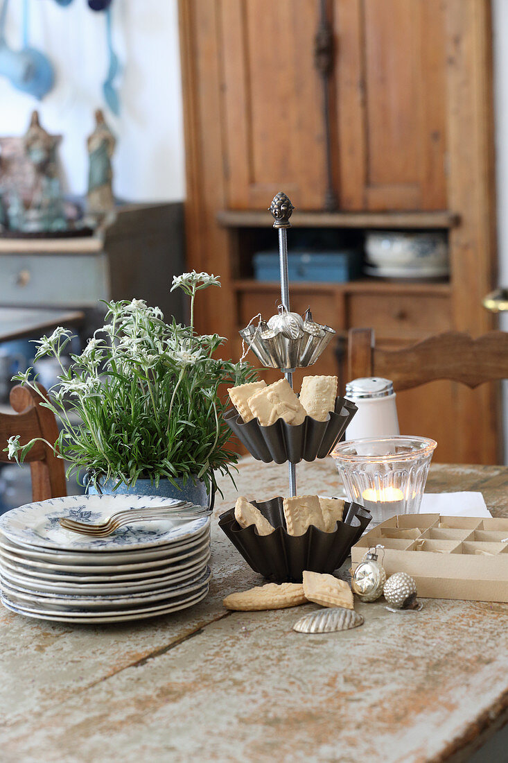 Springerle biscuits in cake stand made from cake tins on table