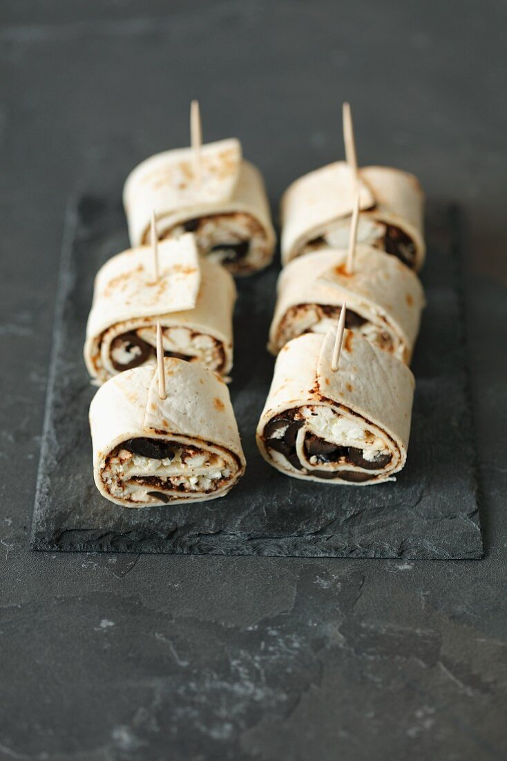 Tortilla rolls with tapenade, black olives and feta