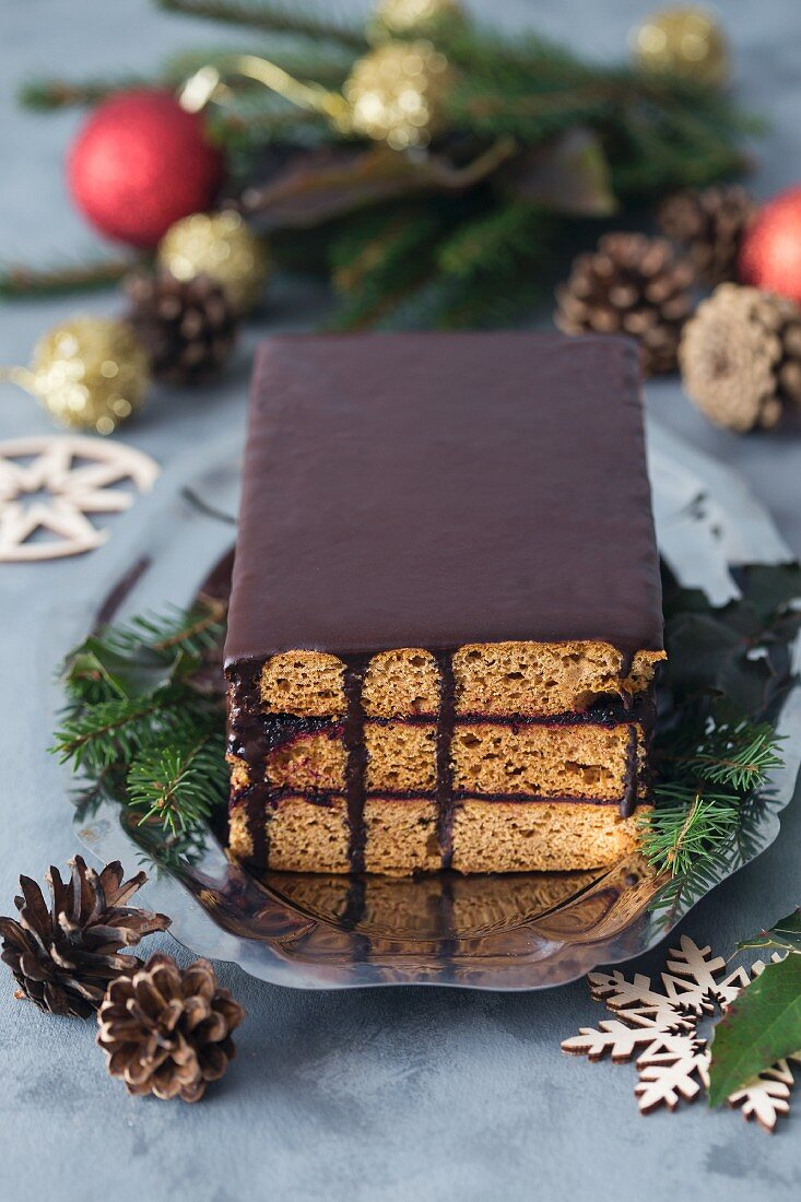 Traditional Polish gingerbread cake with plum jam and chocolate ganache