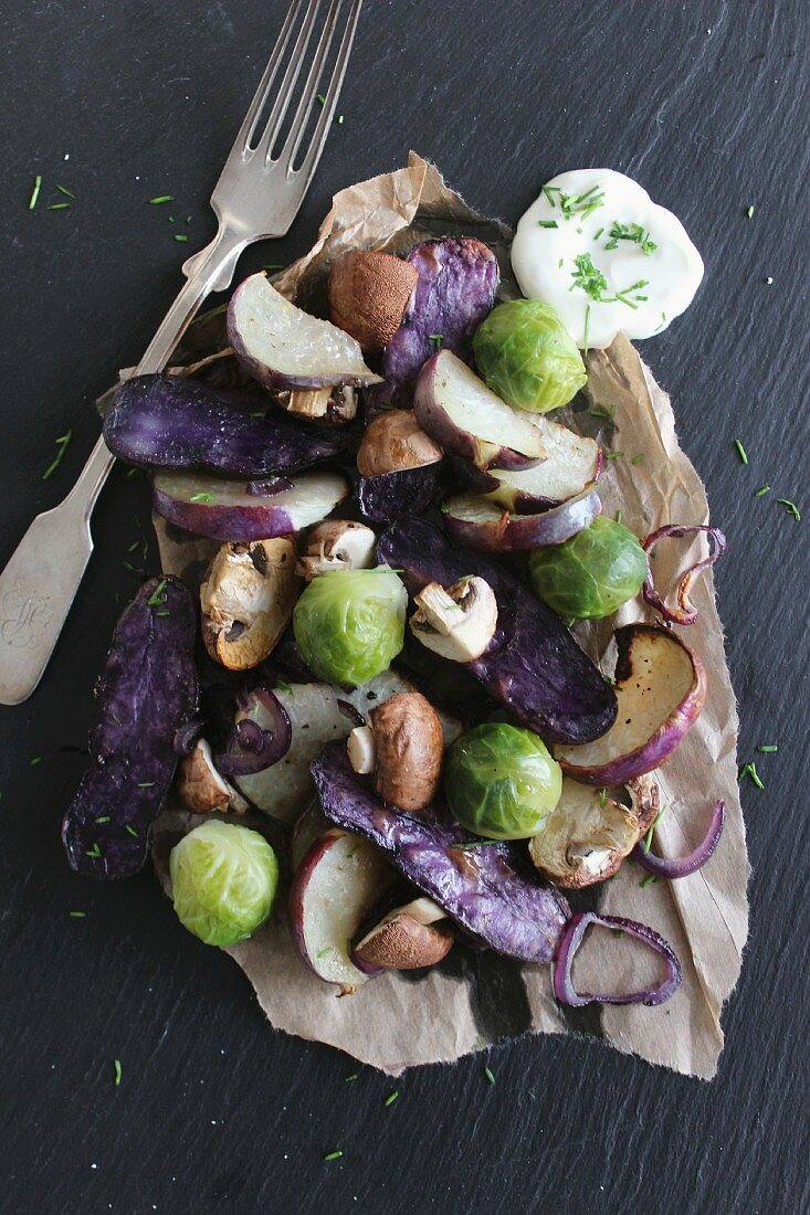 Oven-roasted winter vegetables with dill yoghurt dip