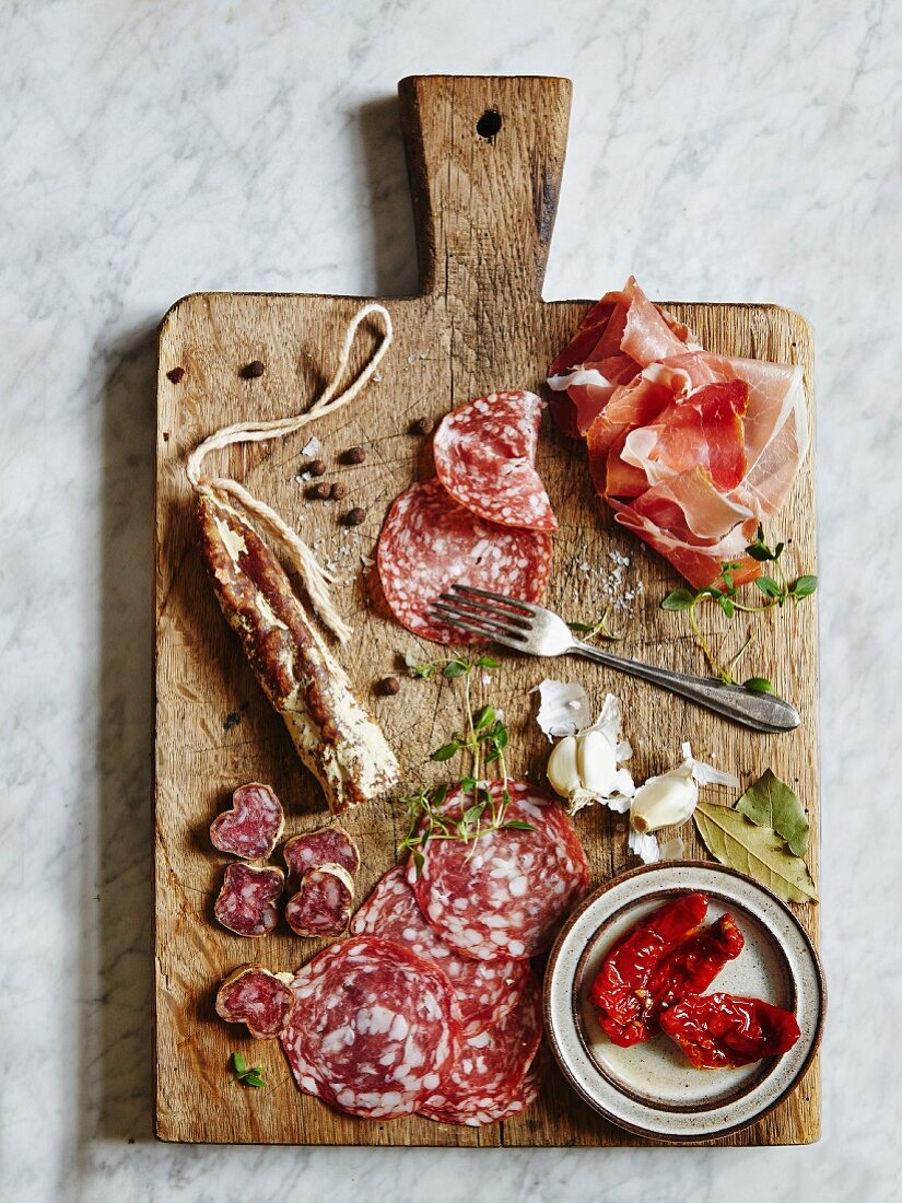 Fine meats and delicatessen. Served on a vintage cutting board