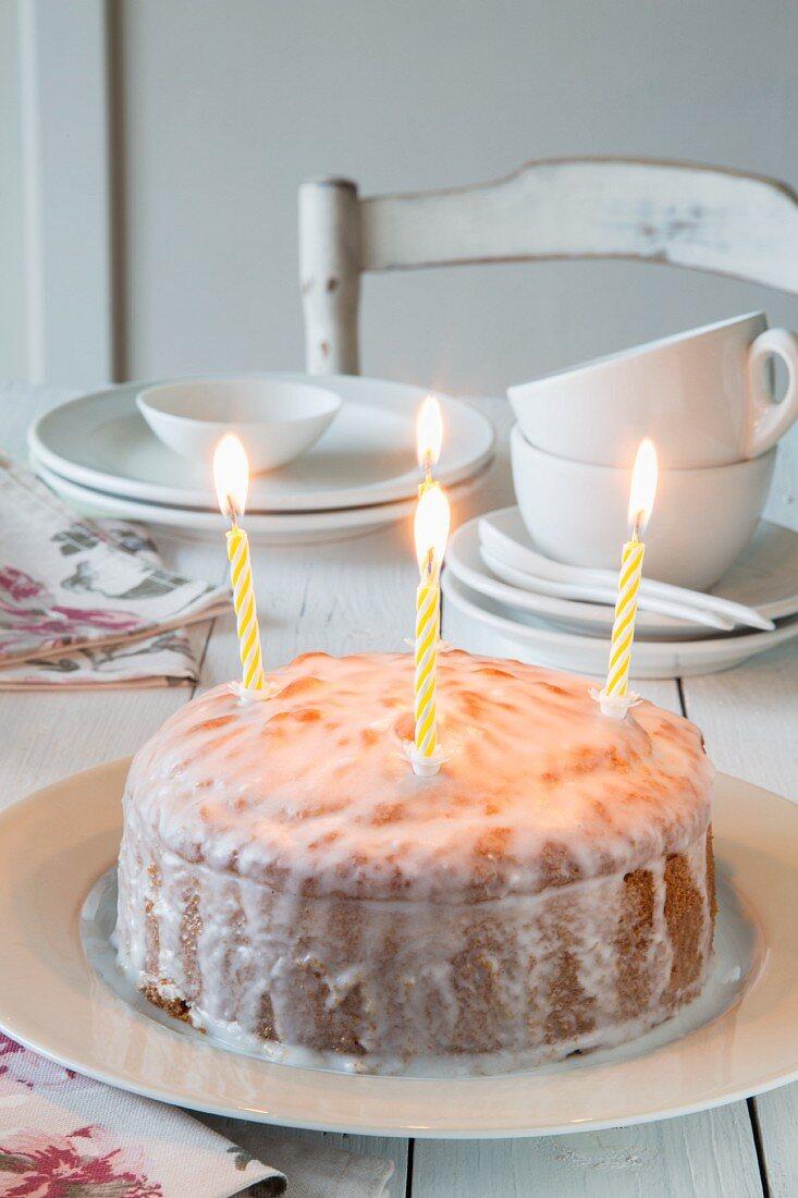 Lemon cake with birthday candles
