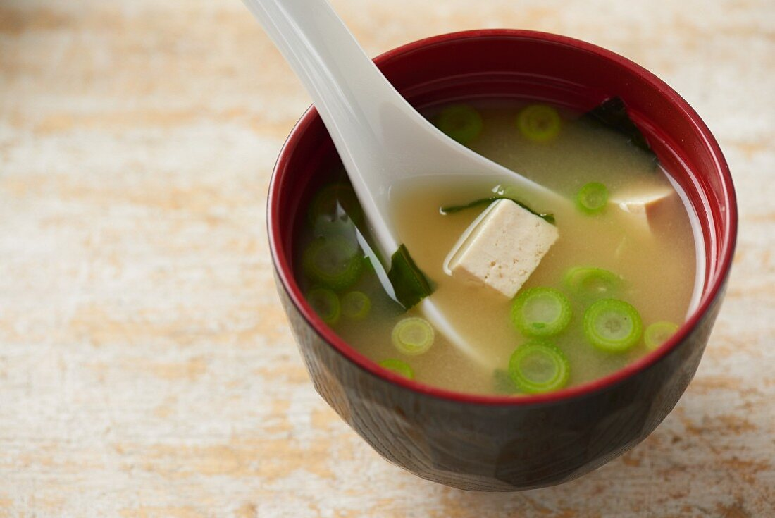 A bowl of miso soup in a traditional Japanese miso bowl
