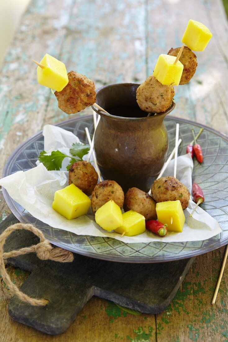 Fried turkey kebabs with curry and pineapple