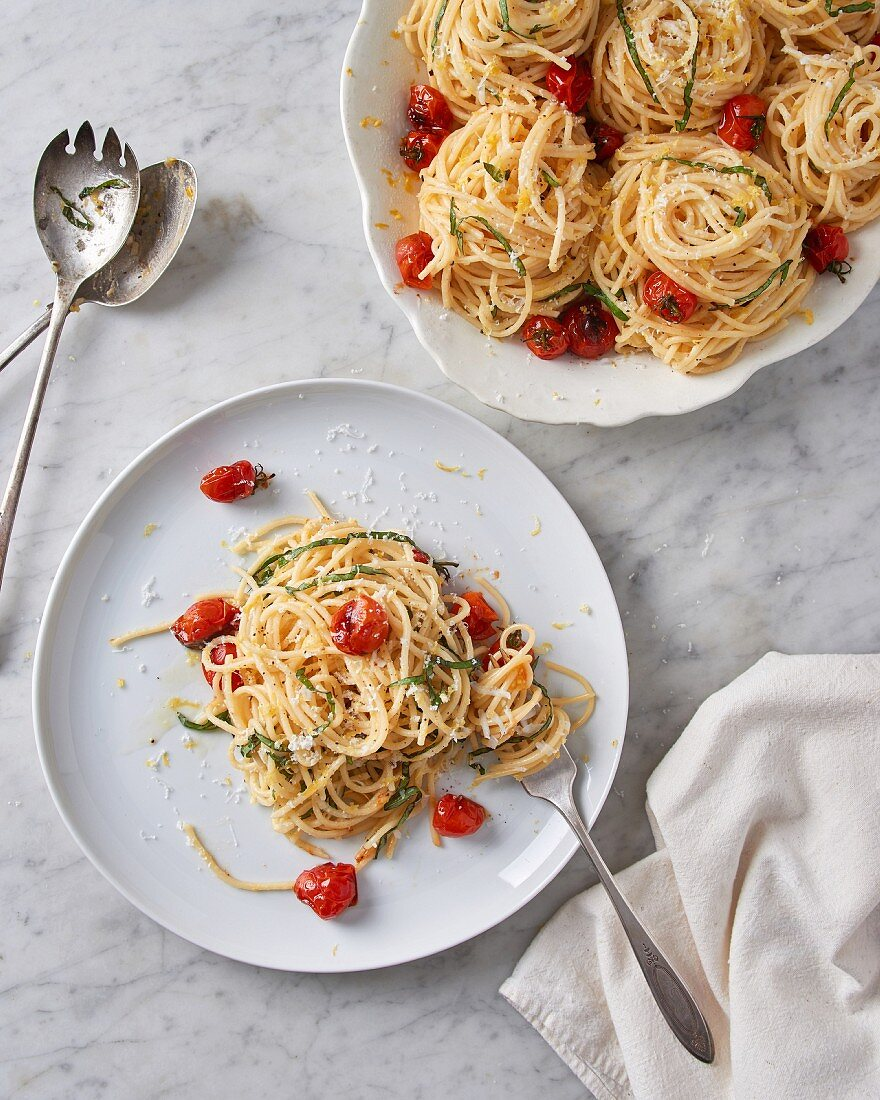Spaghetti al limone with blistered cherry tomatoes