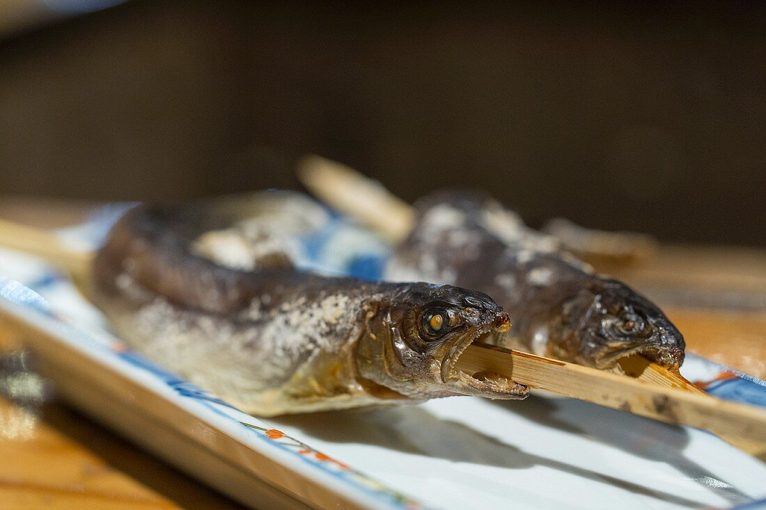 Grilled trout at the Robata Grill restaurant in Hakobune, Japan