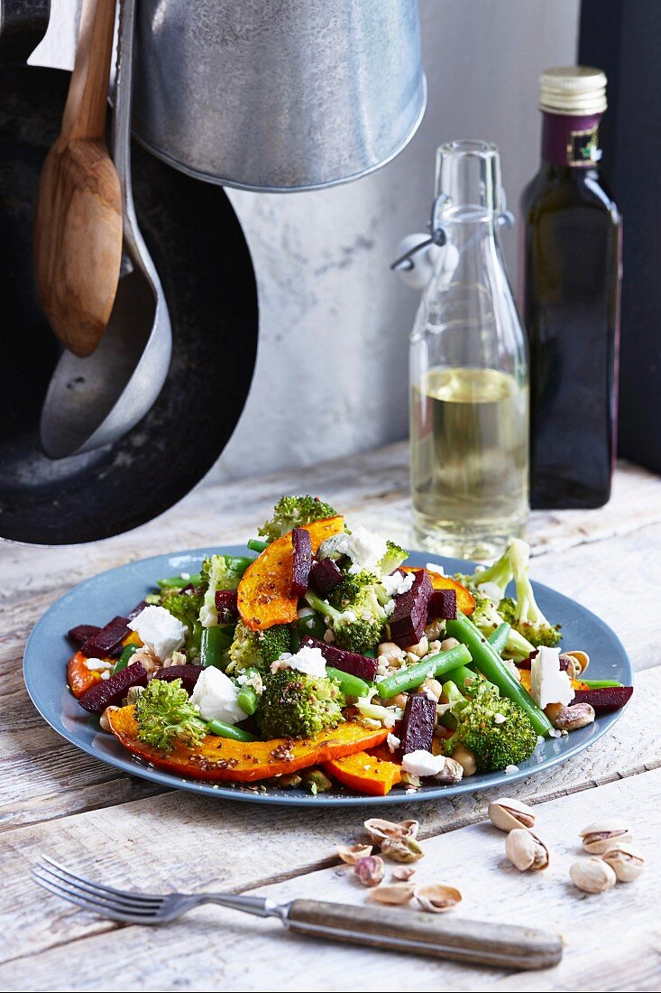 Grilled pumpkin salad with chickpeas, beans, beetroot and pistachios
