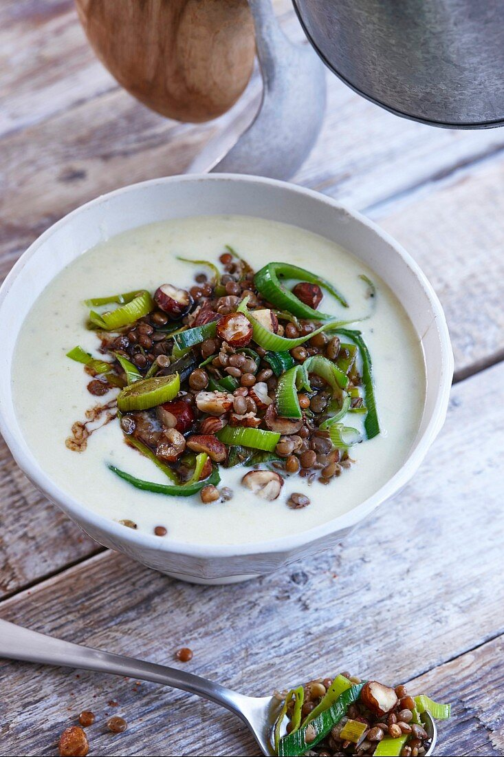 Leek and cheese soup with lentils and nuts