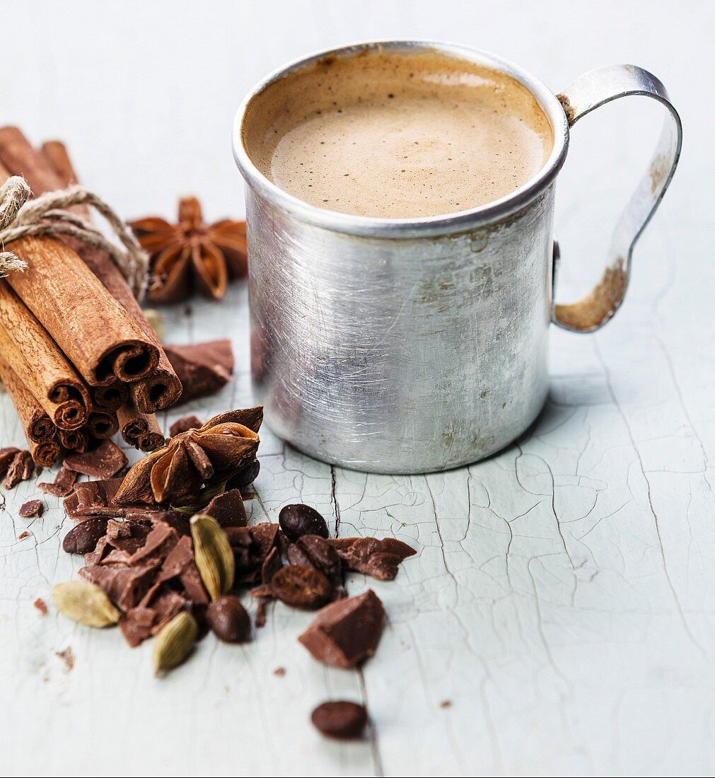 Coffee in aluminum mug with spices